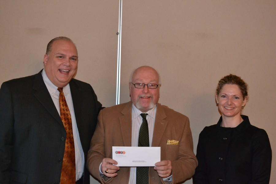 Executive Director Gark Parks with Frank Pellegrino, vice chair of First Community Foundation Partnership, and Trisha Marty, chair of Williamsport Lycoming Regional Advisory Board as well as a member of FCFP