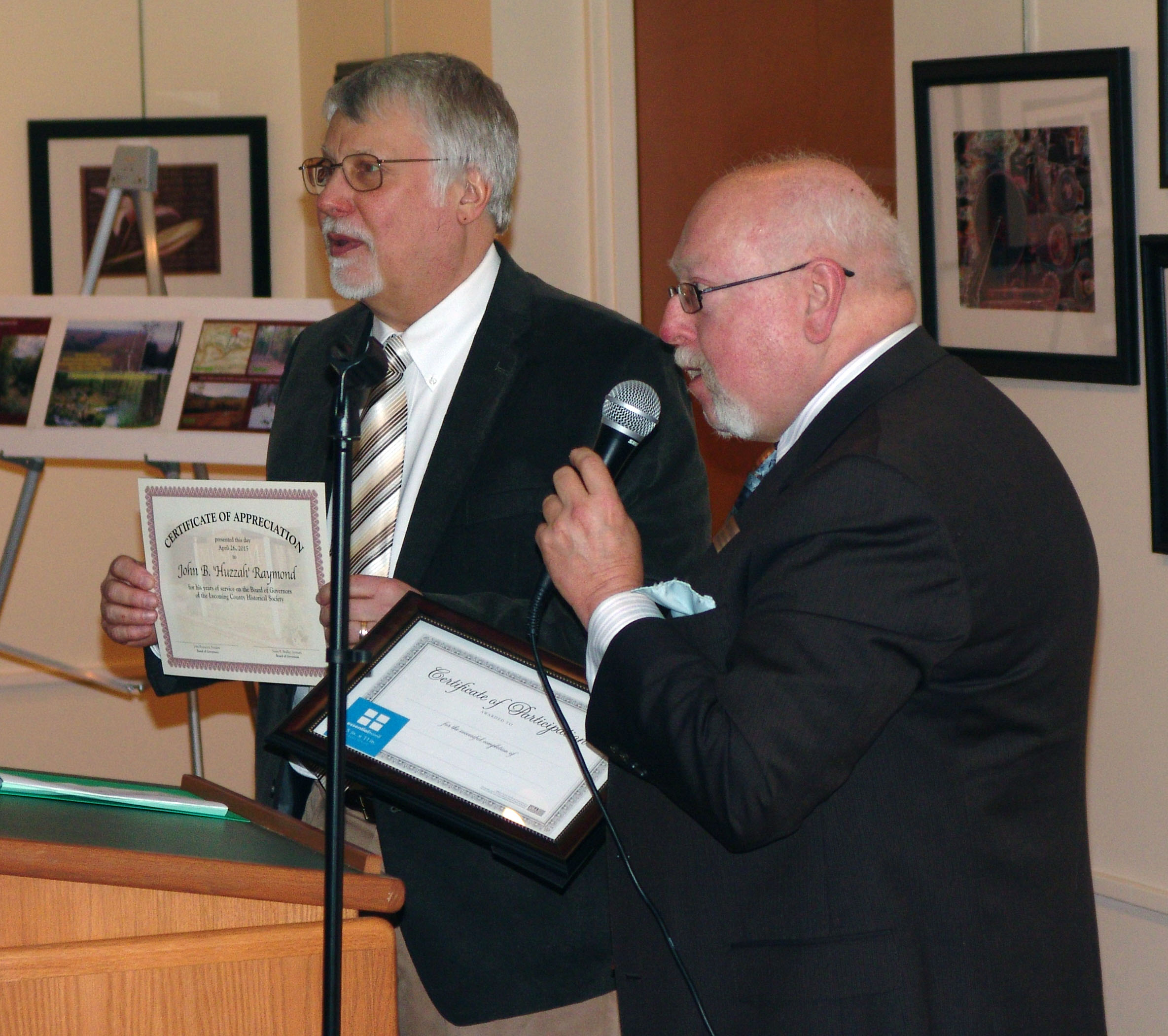 Director Gary Parks presented outgoing Board President John Raymond with a certificate of appreciation.