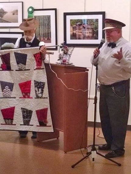 Director Gary Parks welcoming the group and showing the quilt and centerpeice that was up for raffle!