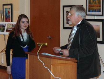 Lycoming County Historical Society President John Raymond presents award to Anna Lee Hafer.